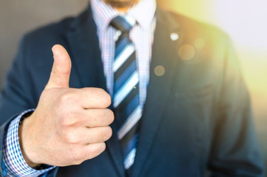 Man giving thumbs up at the office